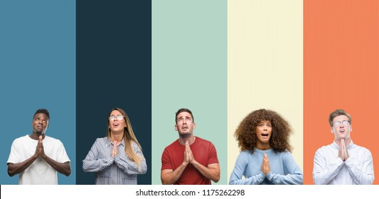 Group of people over vintage colors background begging and praying with hands together with hope expression on face very emotional and worried. Asking for forgiveness. Religion concept.
