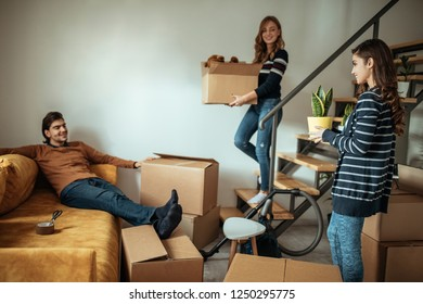 Group of people packing their stuff for moving in new apartment