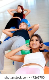 group people in a pilates class at the gym