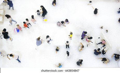 Group Of People Play And Run On The White Bubble Playground Top Aerial View