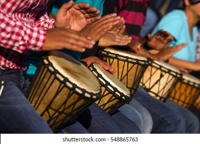 Group of people playing African drums, Djembe,