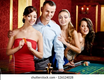 Group of people playing roulette at the casino