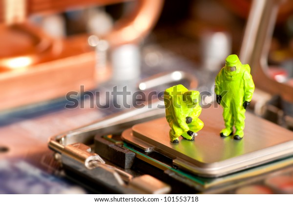 Group of people in protective suit inspecting computer processor