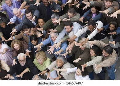 Group of people raising hands all together