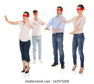 Group Of A People With Red Ribbon Tied On Eyes Isolated Over White Background