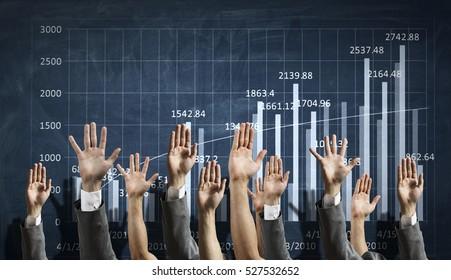 Group of people rise hands