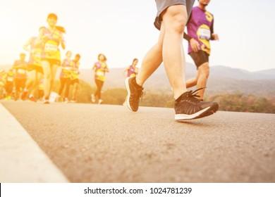 Group of people running race marathon.