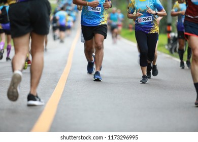 Group of people running race marathon