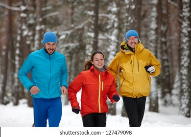 Group of people running in winter