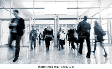 group of people rushing at a International Trade Fair entrance
