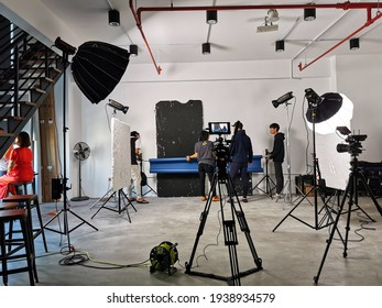 A group of people setting up the video shooting in the studio in Selangor, Malaysia - March 2020