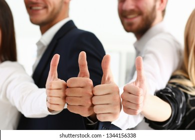 Group of people show OK or confirm with thumb up during conference closeup concept.