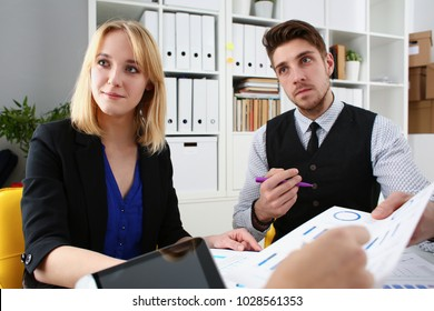 Group of people sit in office deliberate on