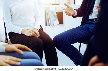 Group of people sitting in a circle during therapy in office. Meeting of business team participating in training
