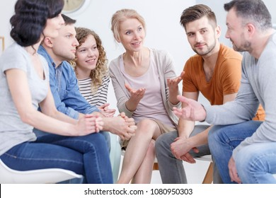 Group of people sitting in a circle, showing support to a man fighting alcohol addiction