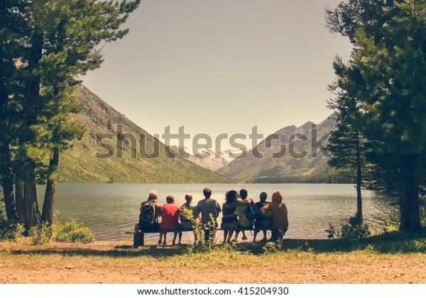 Amazing Group People Sitting On Wooden Bench Stock Photo Edit Now Bralicious Painted Fabric Chair Ideas Braliciousco