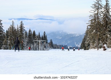 Group of people skiing downhill on a ski slope