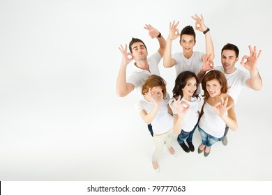 group of people smiling, approving at the camera