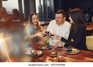 Group of people spend time at a fancy restaurant