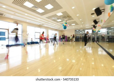 group people in sport dress at fitness dance exercise or aerobics. out of focus