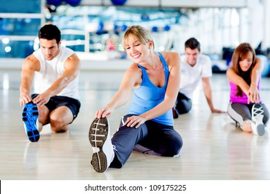 Group of people stretching at the gym