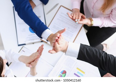 Group of people in suits crossed hands in pile for win closeup. White collar leadership high five cooperation initiative achievement corporate life style friendship dea, heap stack concept