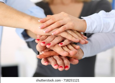 Group of people in suits crossed hands in pile for win closeup. White collar leadership, high five, cooperation initiative achievement, corporate life style, friendship deal, heap, stack concept