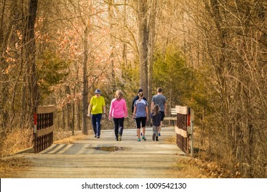 Group of people taking a walk in the park on a nice early spring day; Missouri, Midwest