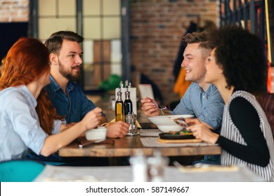 Group of people talking and having fun at dinner party.