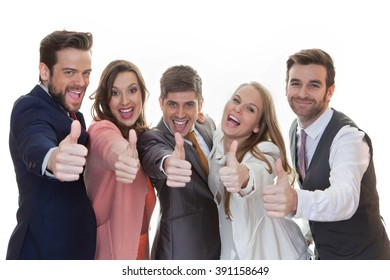 group of people with thumbs up for success