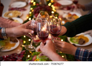 Group of people toasting for Christmas