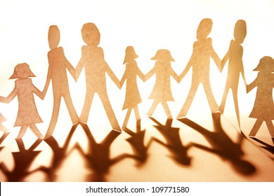 Group of people together holding hands