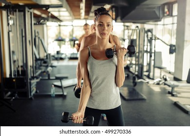 Group of people training in gym together