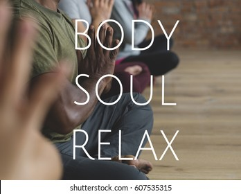 Group of people training in yoga class for body soul and mind relief