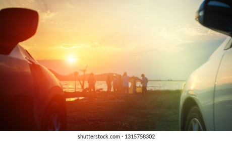 Group of People travel camping by cars at sunset blur.