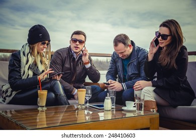 Group of people using cell phone