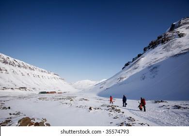 A group of people walking along a path ouside Longyearbyen, Spitsbergen, Svalbard, Norway