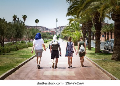 Group of people walking down the street of city Marocco