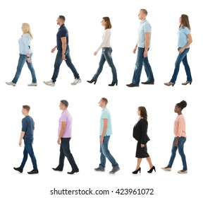 Group Of People Walking In Line Against White Background