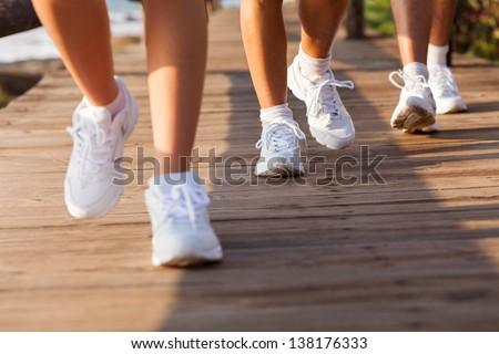 279c2590e ... Stock Photo (Edit Now) 138176333 - Shutterstock. group of people  walking on beach for exercising in the morning