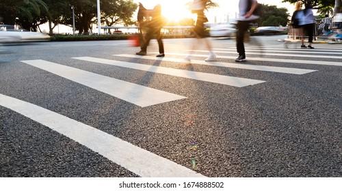 Group of people walking on the crosswalk.