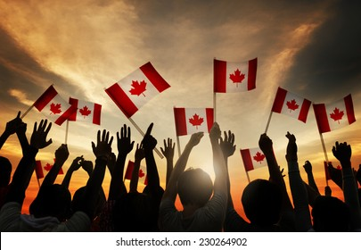 Group of People Waving Canadian Flag