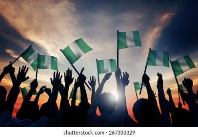Group of People Waving Flag of Nigeria in Back Lit
