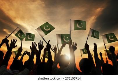 Group of People Waving Flag of Pakistan in Back Lit