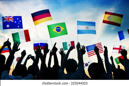 Group of People Waving National Flags in Back Lit