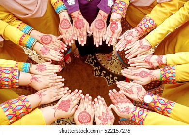 Group of people wearing henna