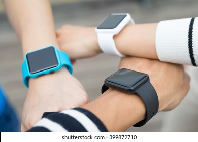 Group of people wearing smartwatch together