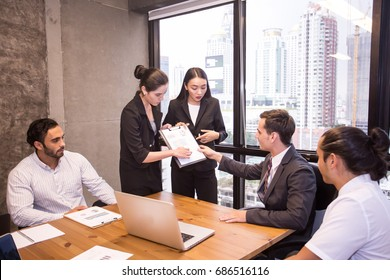 Group of people working at meeting room. Businesswoman present business project with team. People with teamwork concept.