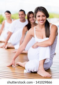 Group of people in a yoga class looking very happy