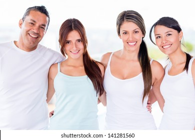 Group of people in a yoga class looking happy